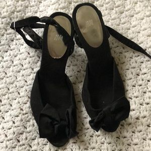 Like new black suede heels with bow in front